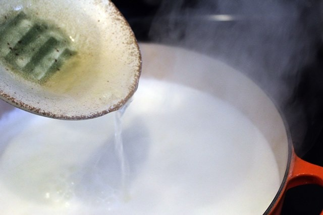 Add acid to boiling milk