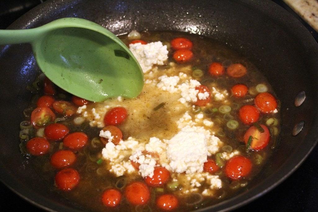Add feta to sauce and stir