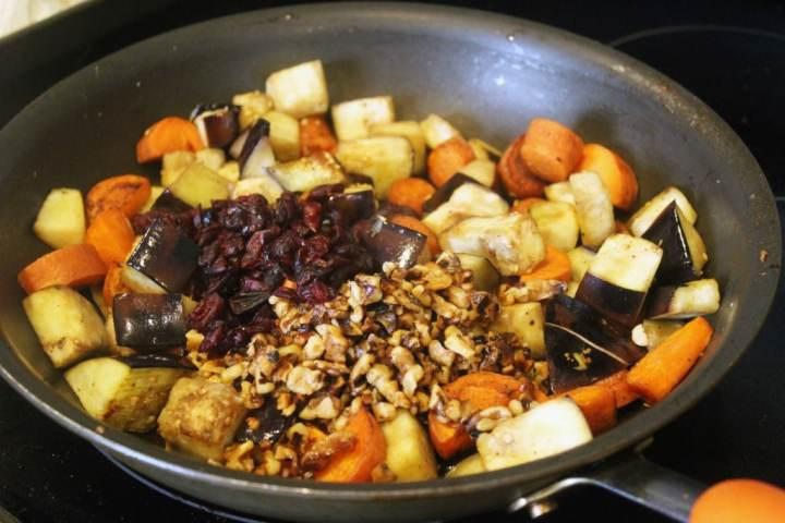 Add craisins and walnuts to veggies