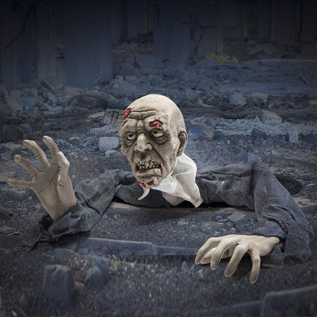 . Creepy Looking Ground breaker Zombie for halloween decoration