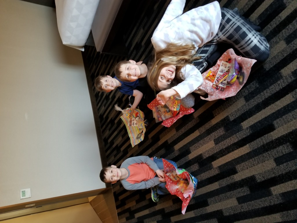 Kids opening gift baskets - Holiday Inn Boston Bunker Hill