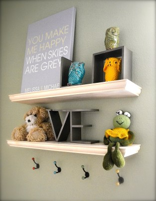 These floating shelves from Home Depot were exactly what we needed to display some of our sweet nursery items. The bear and frog were done by my paternal grandmother - so cute! The hooks below are also from Anthropologie and are now adorned with all our little girls' bows (and there are plenty!)