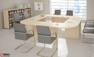 Stół 8 osobowy zbudowany z 4 prostych biurek połączonych półokrągłymi narożnikami