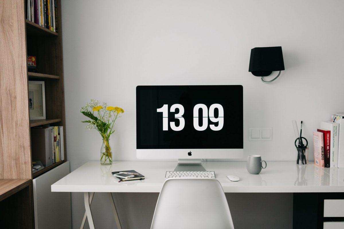 Clean and minimal desk with laptop and chair