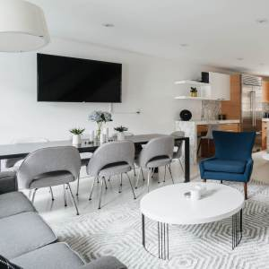 Open living dining room with white walls, New York Apartment