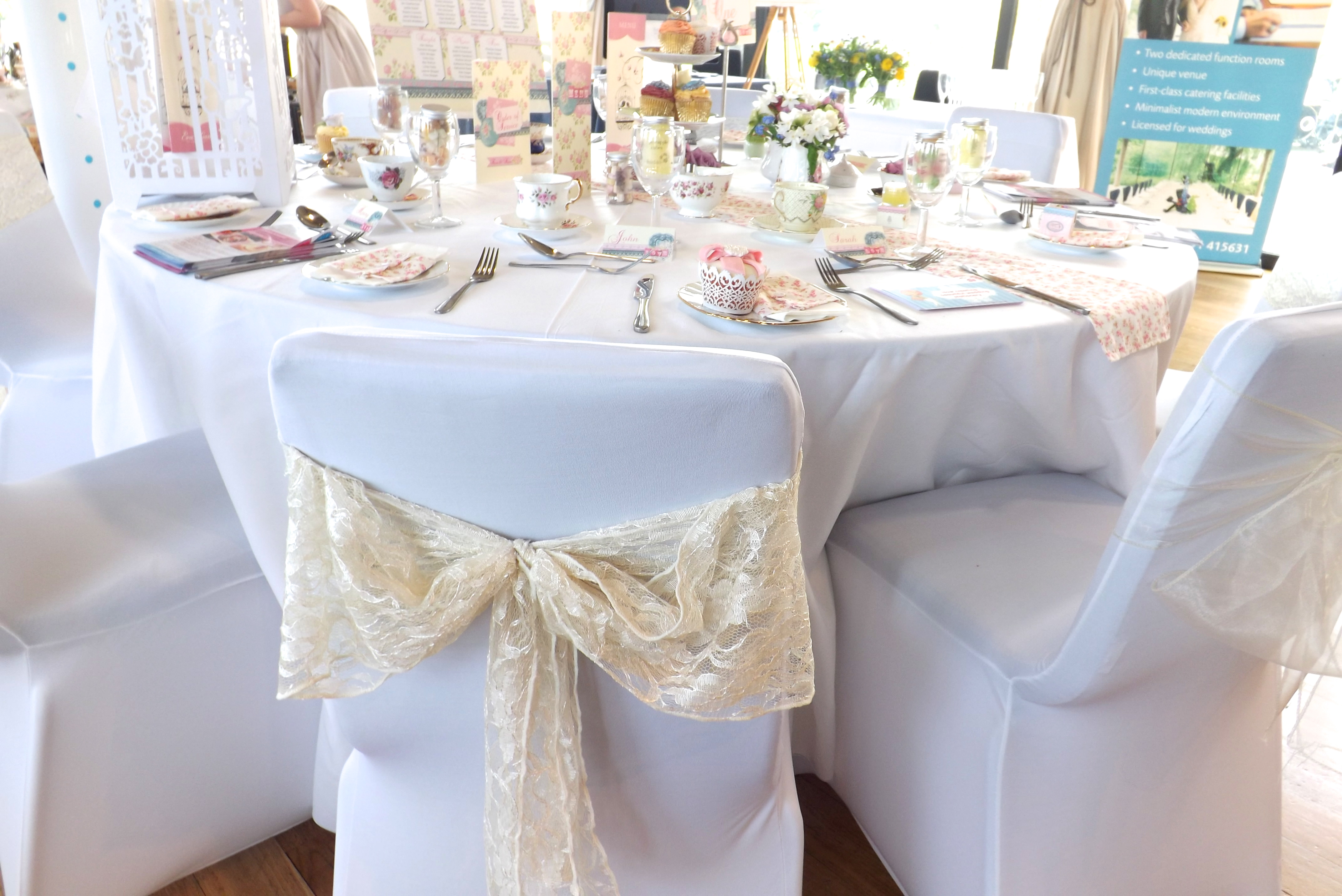 cream chair covers for weddings double saucer black wedding party trends fuschiadesigns vintage lace bows in ivory add that special final touch to any celebration