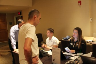 André Braga, Paulo Costa, Chris Dyer, and Lauren Pasquarelli at the F15 registration table