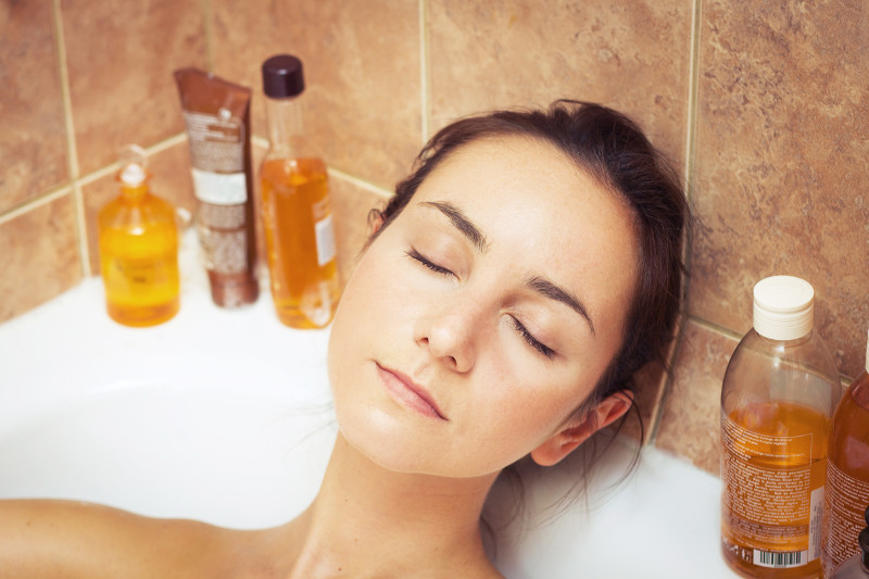 Girl-in-bath-with-oils-relaxing-cbd