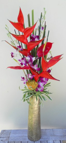 Two hearts beat as one in this tall pairing of exotic tropical flowers.