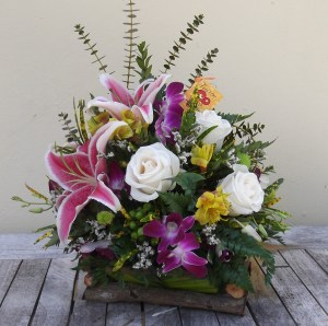 "This country inspired collection of mixed blooms and tropical foliage exudes a rustic vibe. Approx. 16"" H x 12"" W. Our Price: $65"