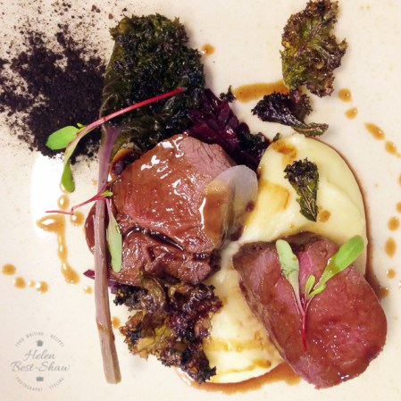 Maple roasted loin of Highland venison with braised red cabbage, kale and aligot potatoes