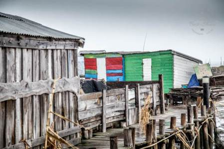 The ramshackle palafitte port of Carrasqueira is build on stilts and is a must visit on any trip to Portugal's Alentejo.