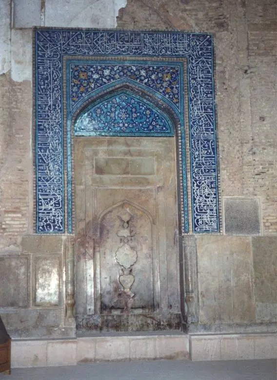 Iran – Esfahan, Jameh Mosque. The stone mihrab, which indicates the direction of Mecca, is decorated with tiling and calligraphy and also carries the traces of Zoroastrianism. Zoroastrian symbolism played an important part in Iranian art and some aspects of Zoroastrianism still appeal to Iranian Muslims. It is interesting to note that Persian churches often incorporate Islamic features.