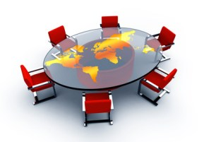 Round conference table with a map of the world