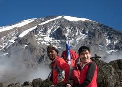 Jack and his guide on top of Mt. Kilimanjaro
