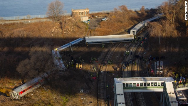 First responders gather around the derailment of a Metro-North passenger train in the Bronx borough of New York on Sunday, December 1. Of eight train cars, at least seven were off the tracks. Source: Craig Rutler/AP