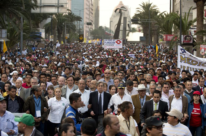 Thousands of protestors march in the streets of Mexico City to protest energy reforms. Source: AFP
