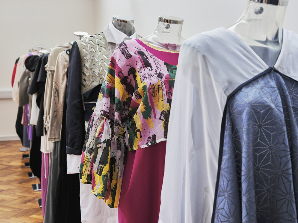 Full length garments on male and female mannequins