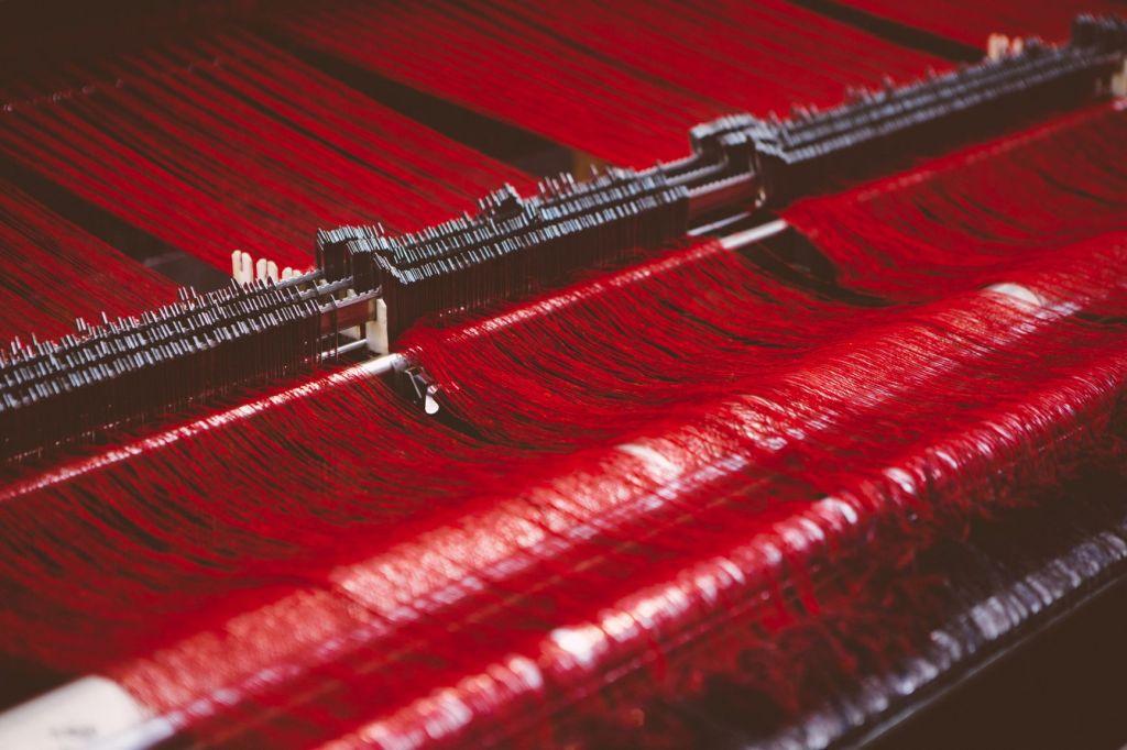 Red yarn on a loom