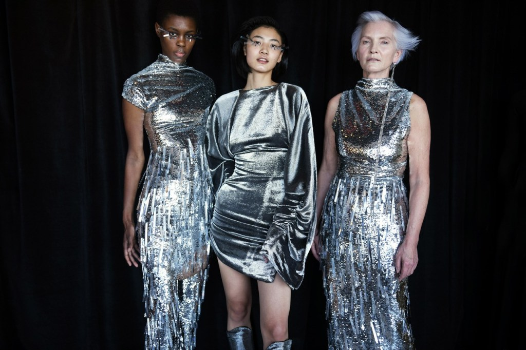 Models wearing silver Paula Knorr gowns, two in sequins and one in silver velvet