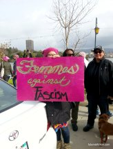 Hot pink protest sign at WOmens March Oakland says Femmes Against Fascism