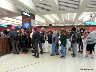 Long line to get into Oakland BART station during Women's March