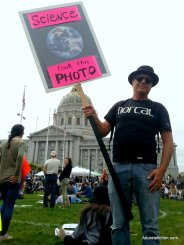 """Protest sign with photo of the earth captioned """"This photo brought to you by science"""""""
