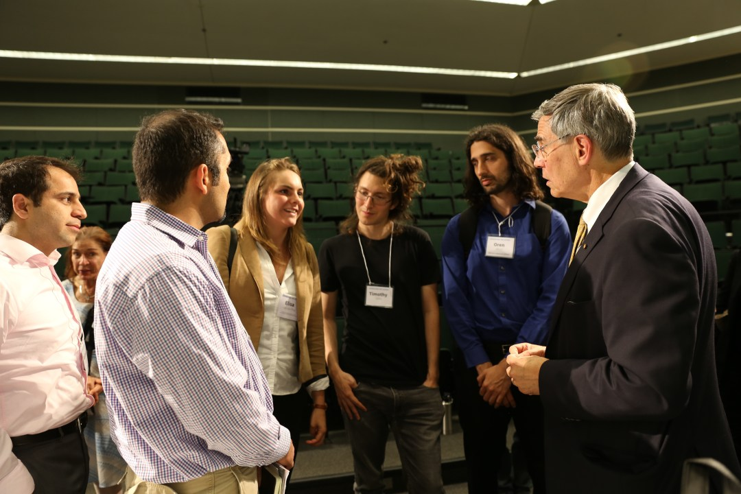Symposium attendees talking with Keynote speaker Rush Holt