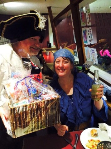 """Mike Balser and Omanie Elias win the """"Best Pirate Couple Costume"""" prize."""