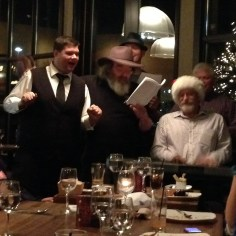 Croy, Adrian, Jeff, Tim and Mike perform a song at the cast party.