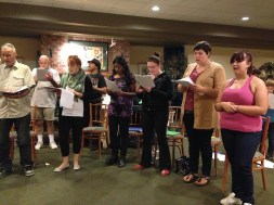 Part of the cast rehearsing some music.