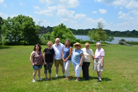 The docents stand together at a lunch given by Joan Bovee on her property in Indiana.