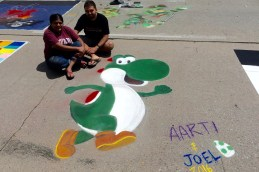 Aarti (L) with her chalk walk design.