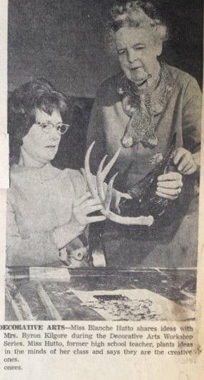 A newspaper clipping shows Blanche Hutto and Mrs. Byron Kilgore working on an art piece.