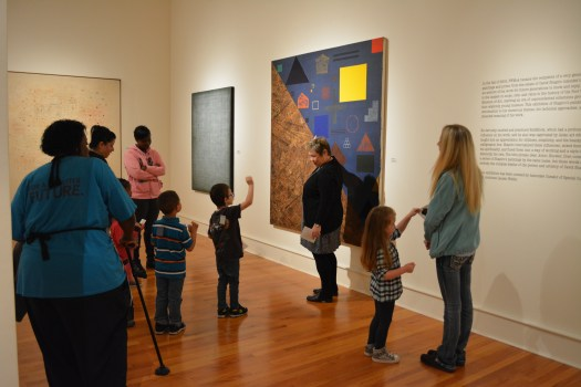 Docent Susan Elser leads some younger museum goers on a tour of David Shapiro's works. With our younger guests, we start with the basics: color, shape and line.