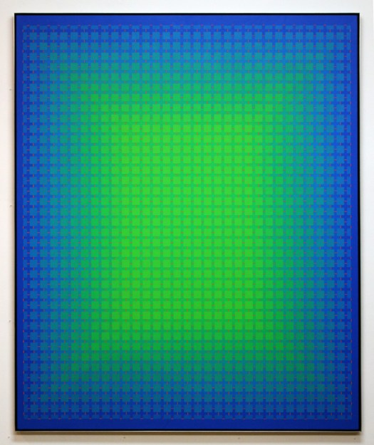 Against a blue background are squares of blue that progressively turn to green, giving the overall effect of a green shade in the middle.