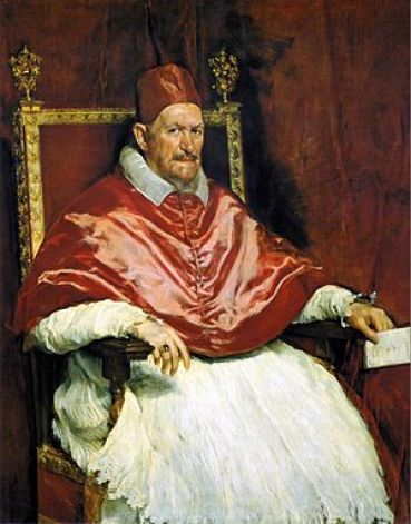 A portrait of Pope Innocent X, seated in a chair with an envelope in his hand.