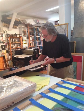 Artist Steven Sorman working in his home studio.