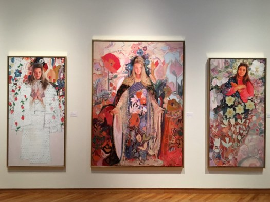 An installation shot of Elly Tullis' exhibition shows her three largest portraits.