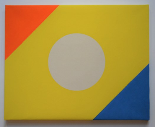 An abstract painting with three colors: orang, yellow, and blue. The yellow band slices through the orange and blue, and in the center of the yellow band is a white circle.