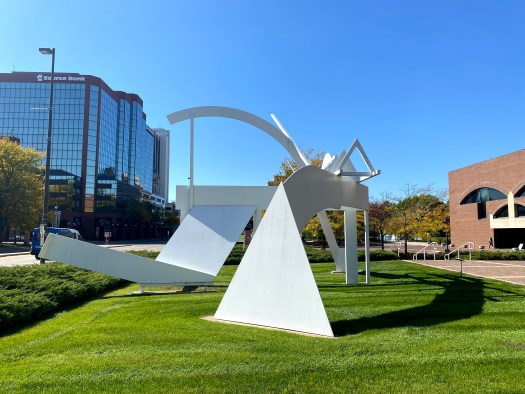 A large, white sculpture of abstracted forms on the grounds of the museum.