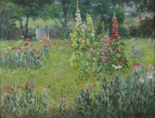 A garden landscape with multiple flowers and a fence in the background.