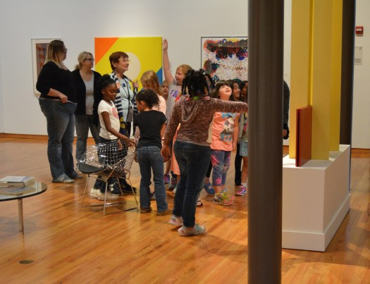 School children raise their hands and point out details in a school tour led by a FWMoA docent.
