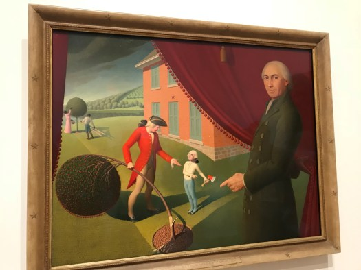 The painting shows a young George Washington holding an axe while his father asks for it back. His father holds the bent cherry tree. The background shows a red house and fields of trees. A man stands in front of the scene, in front of a drawn curtain, pointing at the scene.