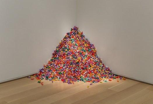 An installation art piece of a pile of candies.
