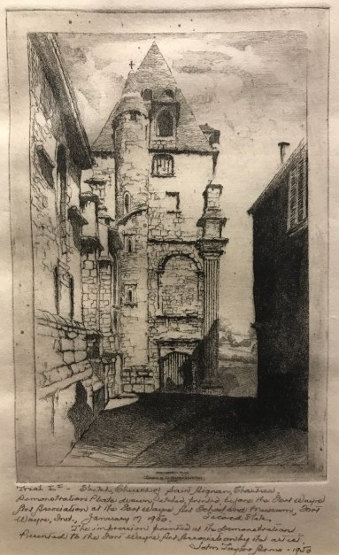 An etching of the Church of Saint Aignan, Chartres, in France shows a shadowed alley leading up to stone buildings. A gate crosses the alley, and a landscape peeks through two buildings into the background.
