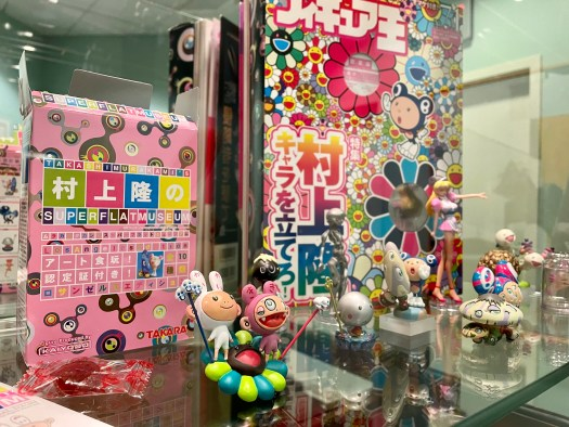 A grouping of Kaiyodo figurines and games.