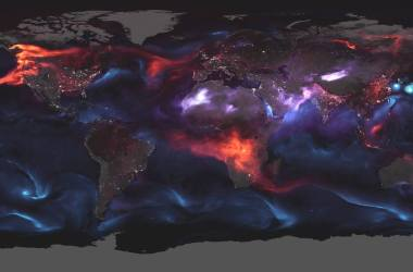 A global map with various aerosols shown in red, purple, and blue