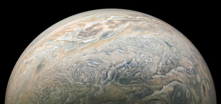 A wide-angle shot showing Jupiter's atomosphere