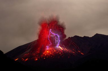A volcanic eruption with purple lightning